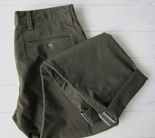 Men's olive chinos folded
