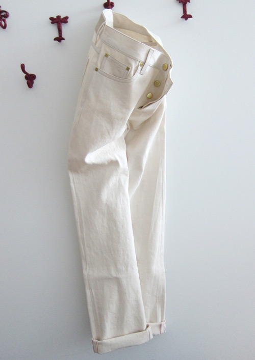 hanging cream colored natural selvedge denim