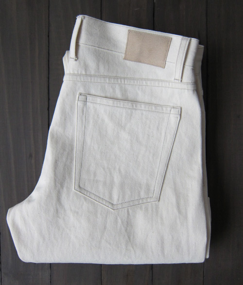 cream colored natural selvedge denim folded