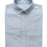 blue oxford cloth button down folded shirt
