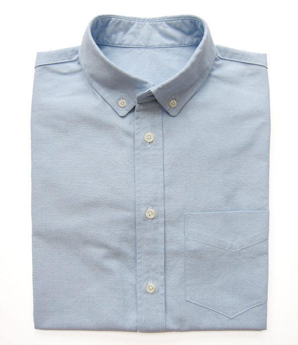 blue oxford cloth button down folded shirt
